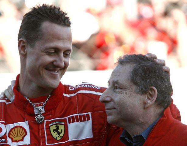 Michael Schumacher embraces Jean Todt