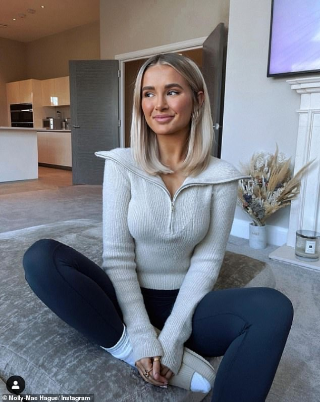 Lounge-wear: Molly-Mae Hague showcased her new natural look to her Instagram followers on Saturday as she posed on her sofa wearing navy leggings and a cream woolly jumper with a zip