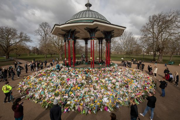 Well wishers look at the floral tributes placed in tribute to Sarah Everard