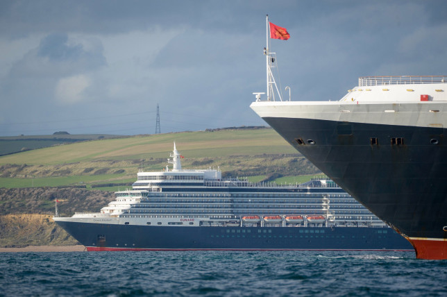 WEYMOUTH - ENGLAND, OCTOBER 22: Cruise ships Queen Elizabeth and Queen Victoria anchored in the English Channel off the Dorset coast as the industry remains at a standstill due to the coronavirus pandemic on October 22, 2020 in Weymouth, United Kingdom. (Photo by Finnbarr Webster/Getty Images)
