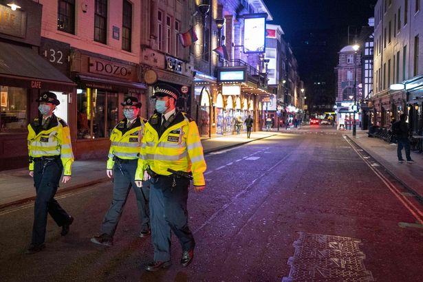 Police patrol in Soho, in central London