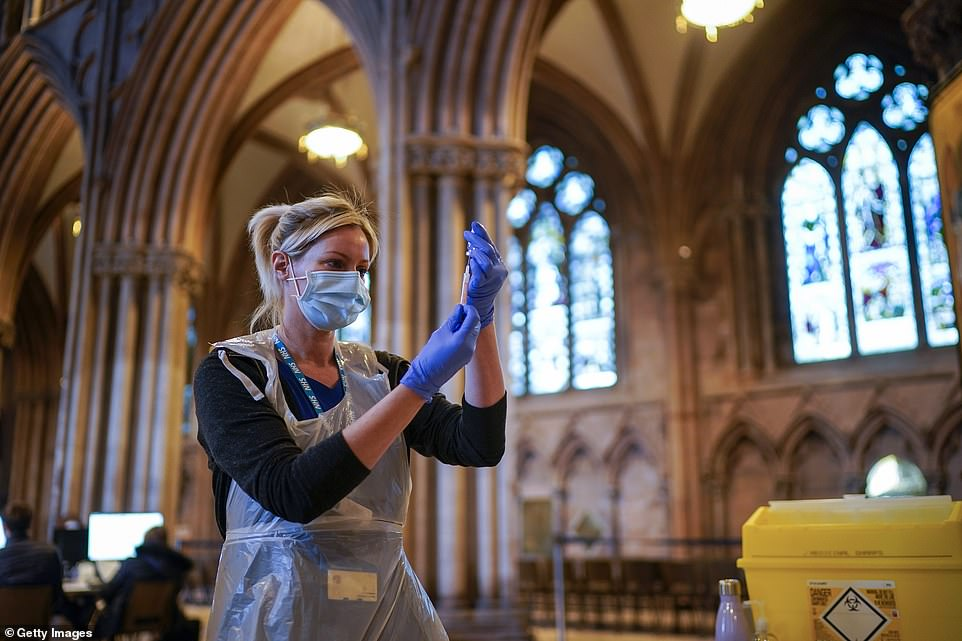 A nurse draws up vaccine the public receive their Covid-19 jabs at Lichfield Cathedral, Staffordshire on February 26, 2021