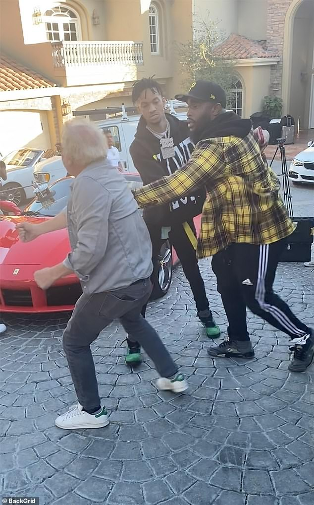 He said he was assaulted by a large associate of the recording artist