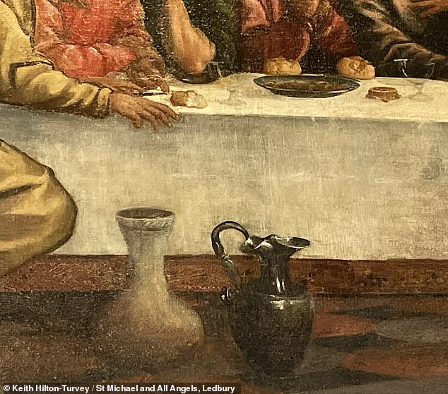 The inscription appears on a black jug on the floor at the foot of the table (pictured) — exactly where the same appears on another version of the Last Supper by Titian