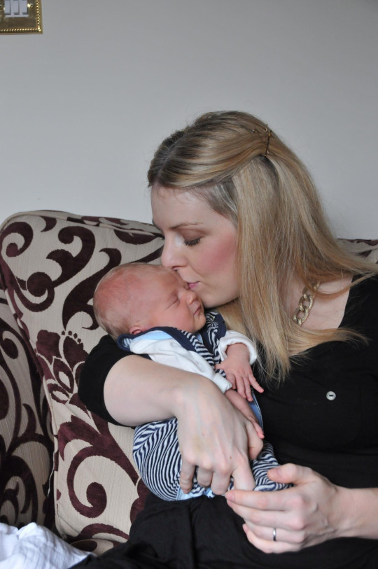 Rachel Tompkins kissed the forehead of her newborn first son