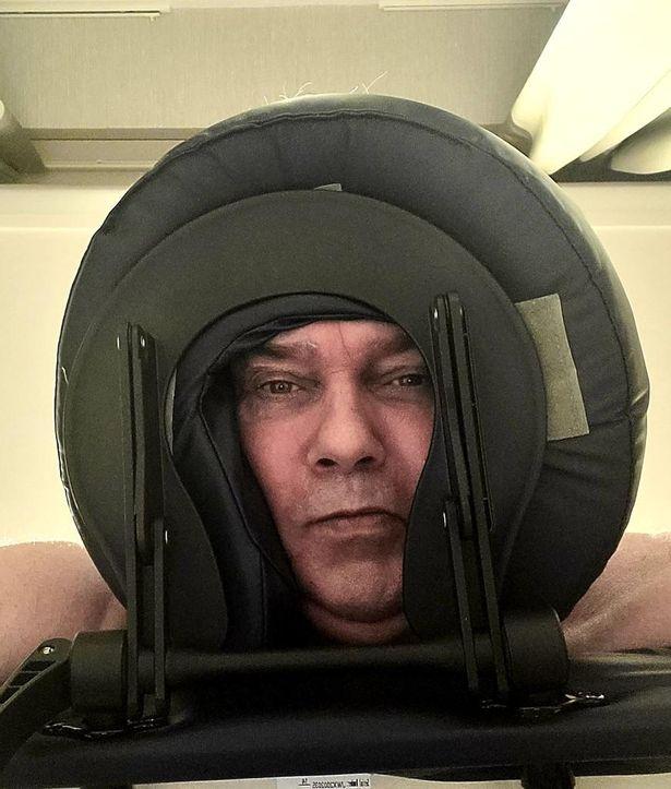 Eamonn Holmes on a massage table