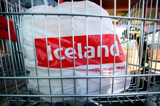 An Iceland Foods Ltd. carrier bag sits in a shopping cart