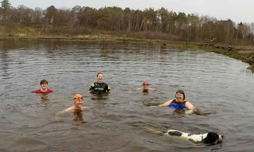 Ella Foote ( right) with friends and Beano the dog swimming in a Chobham Common pond