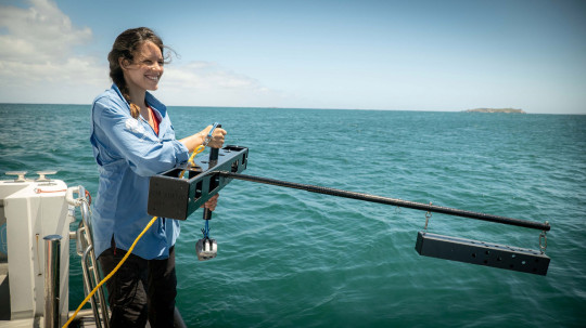 EMBARGOED TO 0001 SATURDAY APRIL 3 Undated handout photo issued by Blue Abacus showing researcher Naima Andrea L??pez with a midwater BRUVS one of a network of underwater camera rigs which are being rolled out across UK Overseas Territories to help protect wildlife under the waves. Issue date: Saturday April 3, 2021. PA Photo. See PA story ENVIRONMENT Marine. Photo credit should read: Blue Abacus/PA Wire NOTE TO EDITORS: This handout photo may only be used in for editorial reporting purposes for the contemporaneous illustration of events, things or the people in the image or facts mentioned in the caption. Reuse of the picture may require further permission from the copyright holder.