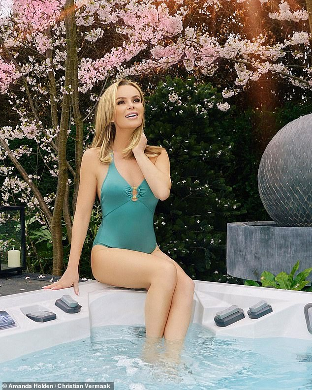 Work it:The TV presenter, 50, exuded confidence as she posed up a storm in the plunging one-piece from her pal Tess Daly's collection while perching on a hot tub