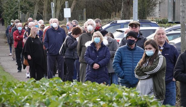 A QUEUE OF PEOPLE WAITING TO BE VACCINATED AT BASINGSTOKE FIRE STATION