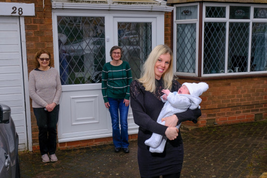 Anne-Marie Duckers with newborn Jack and her two neighbours Jane Fleming, 66 (left) and Melinda Packham, 51