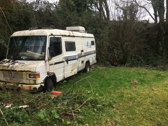 Cosmo before - rusted van in field
