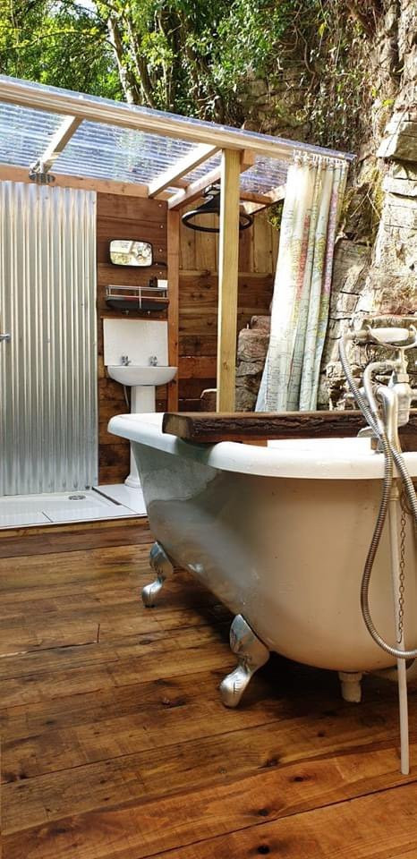 Cosmo exterior - outdoor bathroom with claw foot bath and covered shower