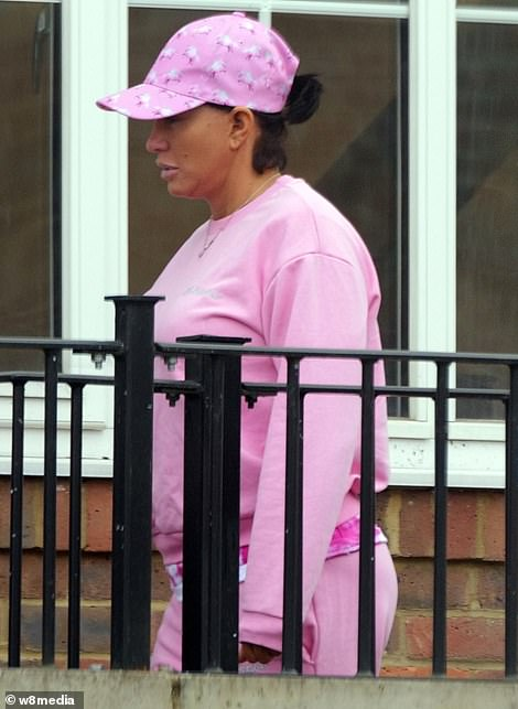 Details: The mother-of-five finished her look with a pink patterned T-shirt