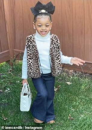 So cute: In the snaps, Kulture looked adorable in a leopard print furry gilet, white polo neck jumper and flared jeans