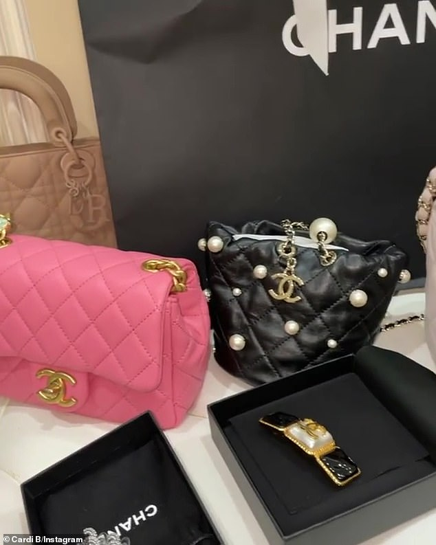 'Oooh I went crazy shopping!' The rapper showcased seven handbags and a bracelet, worth more than £26,600, that she bought her two-year-old toddler during a shopping spree at Chanel and Dior