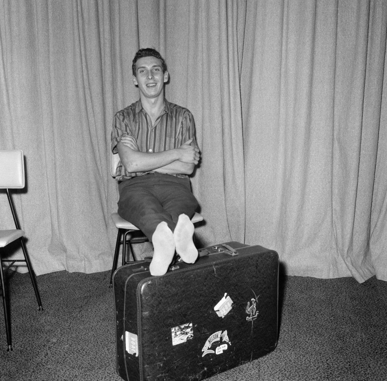 Stiff and limping, home-sick Welshman Brian Robson, 19, who tried to send himself back to Cardiff from Australia arrived at London Airport this morning stiff and limping after his 96 hours in a crate. He had been given a seat in a Pan American jet airliner from Los Angeles, 18th May 1965. (Photo by Tom King/Mirrorpix/Getty Images)