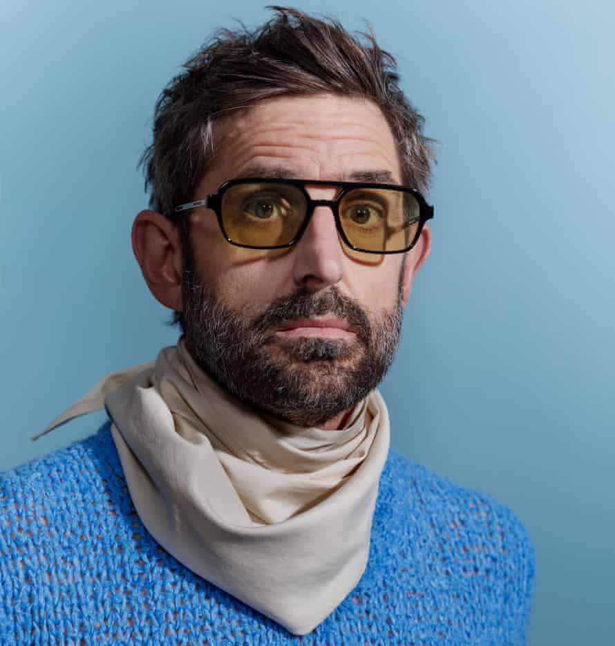 Jumper and scarf, both Jil Sander. Sunglasses, Gentle Monster. Styling: Tanja Martin. Grooming: Petra Sellge at the Wall Group. Fashion assistants Ania Egan and Lauren Mitchell.