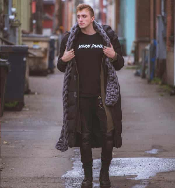 Knitter Vincent Green-Hite wearing a Yarn Punk T-shirt