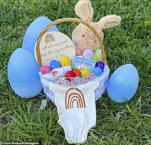 New life:Kara's snaps showed daughter Decker crouching next to three Easter baskets - one for her, one for McCoy and one without a name