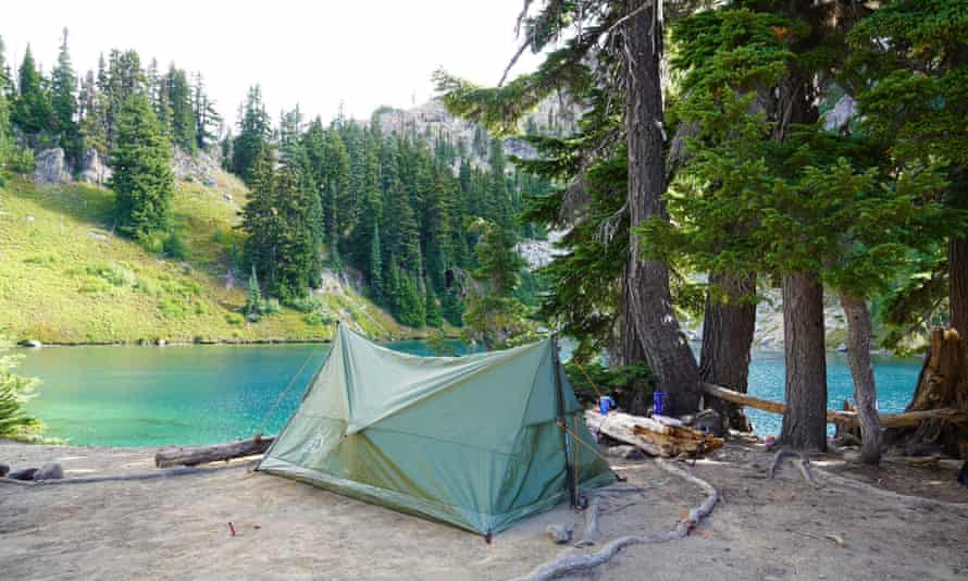 A lightweight tent pitched by the lake.