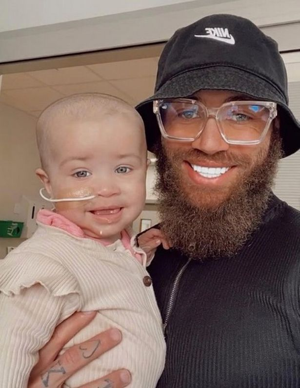 Ashley and baby Azaylia, who keeps smiling despite being so poorly