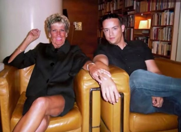 Kyle sitting with an older woman he dated