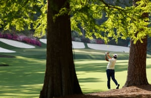 Japan's Hideki Matsuyama hits his approach to the 13th.
