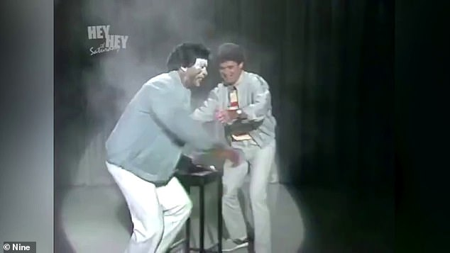 Sorry: It comes after Hey Hey It's Saturday host Daryl Somers (right) apologised to Kamahl and said he 'deeply regrets' humiliating the singer after he spoke out about being racially mocked on the show. A scene on Hey Hey It's Saturday where Kamahl was doused in white powder