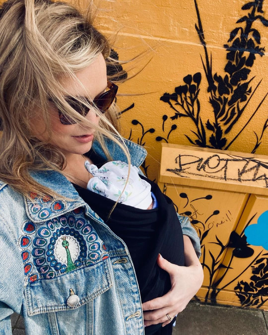 Laura Whitmore and her baby