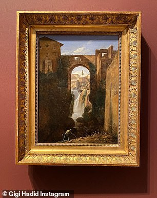 Art: The family also popped into galleries to look at 1800s-era masterpieces like a painting of Ponte San Rocco and Waterfalls, Tivoli by artist Francois-Marius Granet (above)