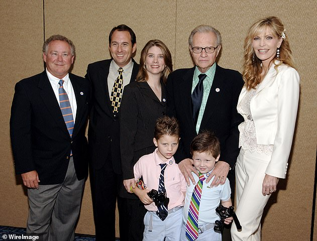 Larry Jr. 59, pictured second from left, was appointed executor based on his father's revised will. His half-siblings Andy, far left, and Chaia, third from left, both died in 2020. Also pictured with their parents are Larry and Shawn's two sons Chance, now 21, and Cannon, now 20