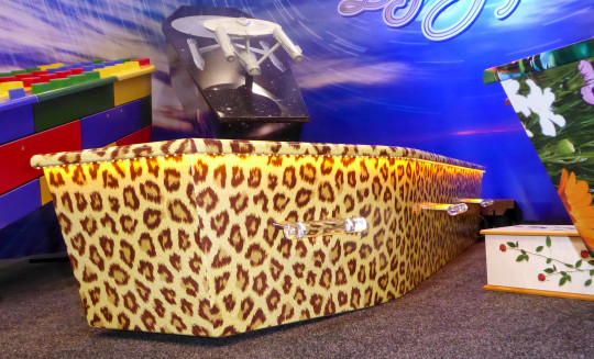 This photo provided by Ross Hall, shows a leopard skinned designed casket in Auckland, New Zealand on March 17, 2016. Auckland company Dying Art makes unique custom caskets which reflect the people who will eventually lay inside them, whether it's a love for fire engines, a cream doughnut or Lego. (Ross Hall via AP)