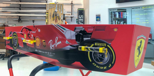 This photo provided by Ross Hall a casket in the design of a Ferrari F1 car in in Auckland, New Zealand on Dec 10, 2018. Auckland company Dying Art makes unique custom caskets which reflect the people who will eventually lay inside them, whether it's a love for fire engines, a cream doughnut or Lego. (Ross Hall via AP)