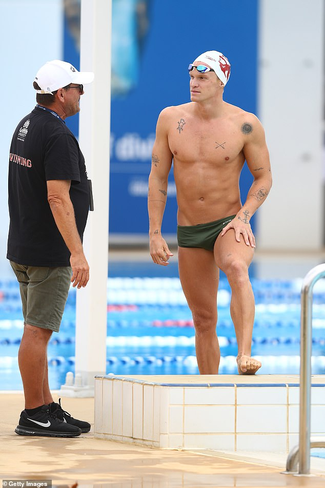 Dressed in the national colour of green, the singer-turned-aspiringOlympian's muscular physique was on show as he made his way around the pool.