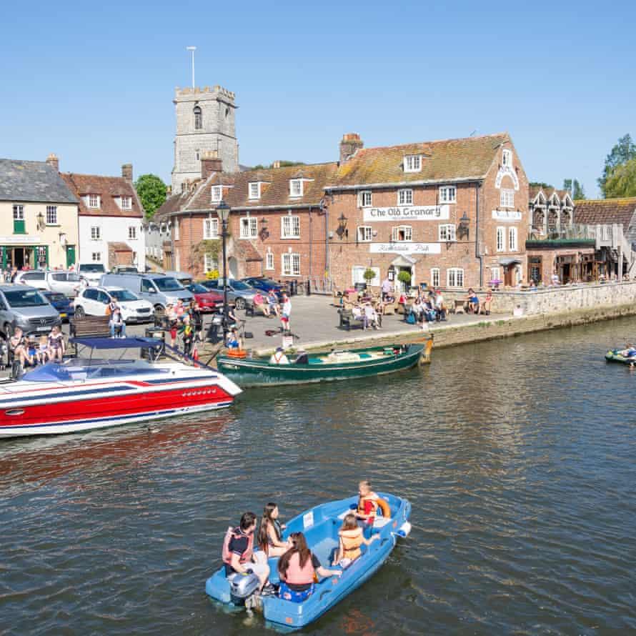 Boating on the River Frome, Wareham Quay, Wareham, Dorset, England, United Kingdom