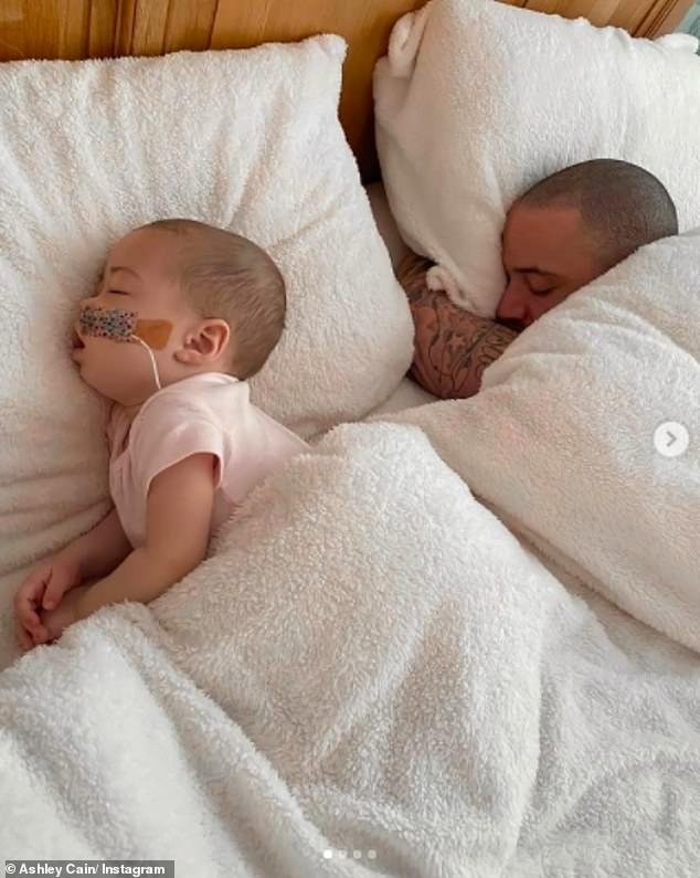Together: Safiyya'sposts come after Ashley shared sweet snaps cuddling with Azaylia in bed and said he feels 'truly blessed to have another day with you' amid her leukaemia battle