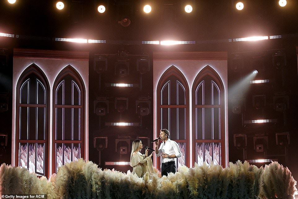 Take it to church: They were on a set designed like a church set with tall arched windows