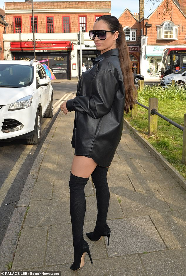 Making an entrance: Nicole,29, kept warm beneath an oversized leather jacket and gave her look added edge with a pair of enormous black sunglasses