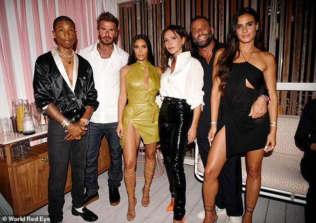 Party pack: Meanwhile, Kim just arrived back in Los Angeles after partying up a storm in Miami. She is pictured with Pharrell Williams, David and Victoria Beckham and David Grutman and his Isabela