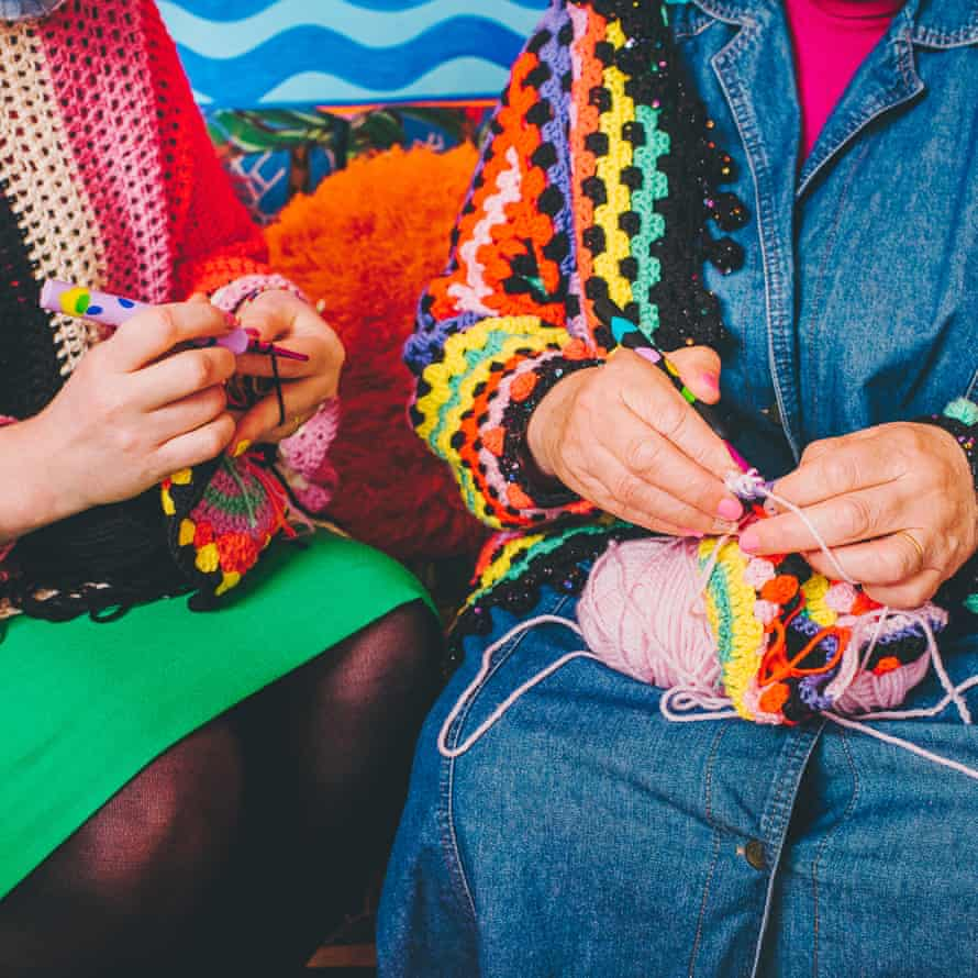 Two women crocheting