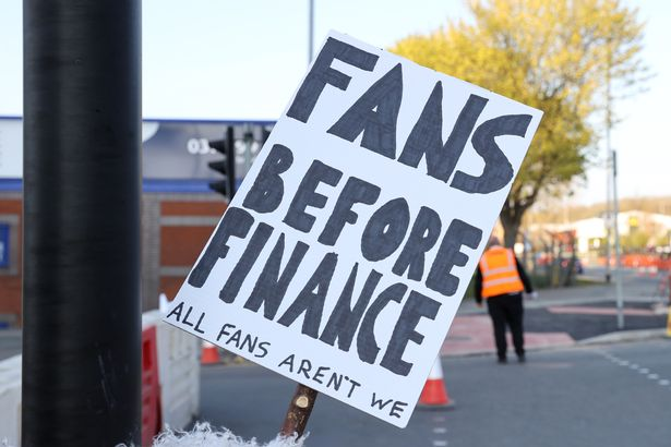 """A Fan sign is seen reading """"Fans before finance, All fans aren't we"""" as a protest against the European Super League outside the stadium prior to the Premier League match between Leeds United and Liverp"""