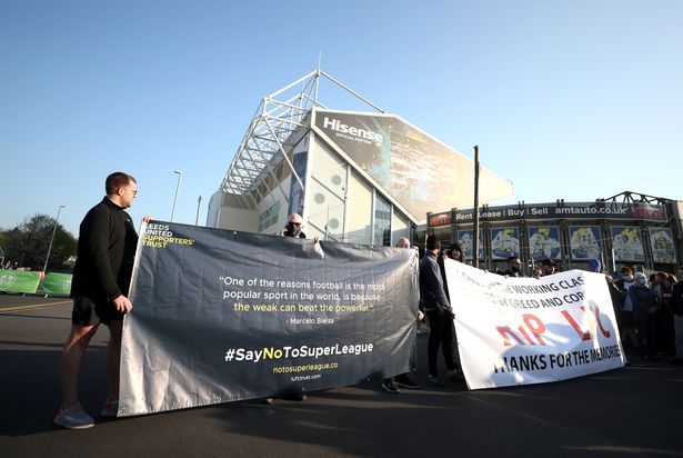 Fans protest outside Elland Road against Liverpool's decision to be included amongst the clubs attempting to form a new European Super League. Picture date: Monday April 19, 2021