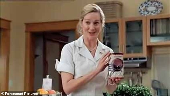 Pictured, Laura Linney as Hannah Gill, acting as Meryl Burbank holding cocoa in the 1998 film The Truman Show. In the film, Jim Carrey's character Truman Burbank starts to realise his life is part of a 24-hour reality TV show when Meryl, his wife, name-checks big-name brands