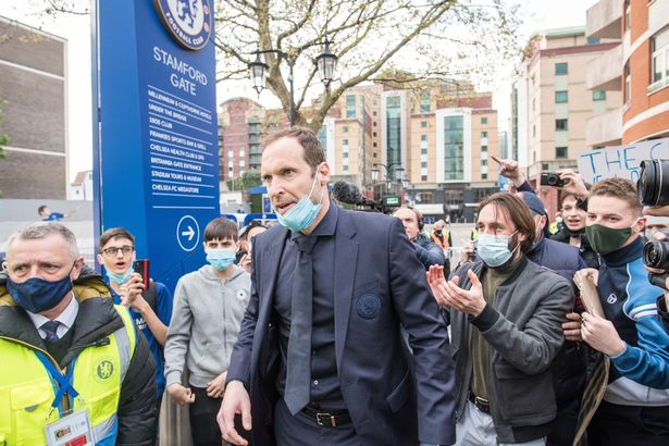 Petr Chech talking with fans who protest against Super League before the Premier League match between Chelsea and Brighton & Hove Albion at Stamford Bridge on April 20, 2021 in London, United Kingdom.