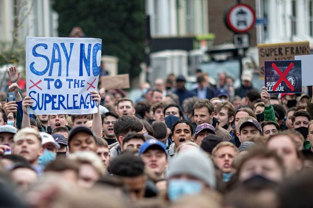 Fans of Chelsea Football Club protest against the European Super League outside Stamford Bridge on April 20, 2021 in London, England. Six English premier league teams have announced they are part of plans for a breakaway European Super League