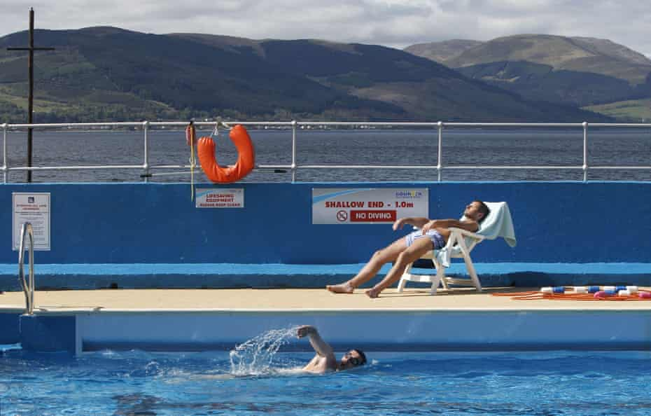 Ryan Robertson relaxes by Gourock Outdoor Pool in Scotland as the hot weather continues.