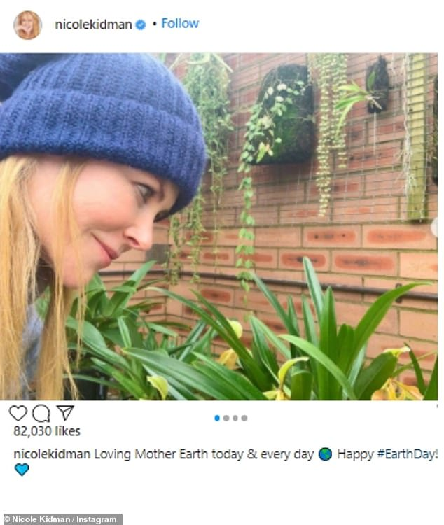 Nicole Kidman wore a knit beanie as she looked at plants. 'Loving Mother Earth today & every day Happy #EarthDay,' said the Big Little Lies star.