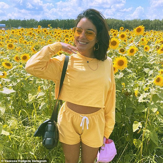 Vanessa Hudgens posed in yellow in a sunflower field as she said: 'Happy Earth Day'